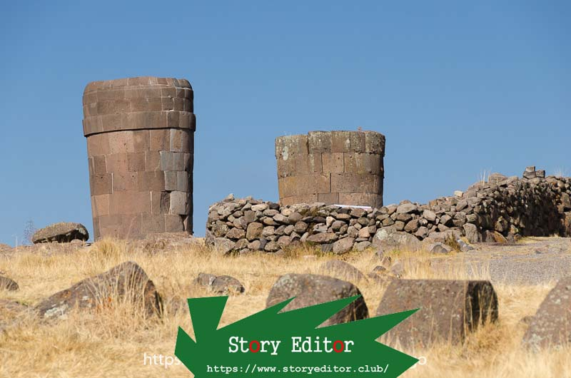 two ancient inverted cone shaped tombs made of stone in sillustani one of the wonderful places of peru