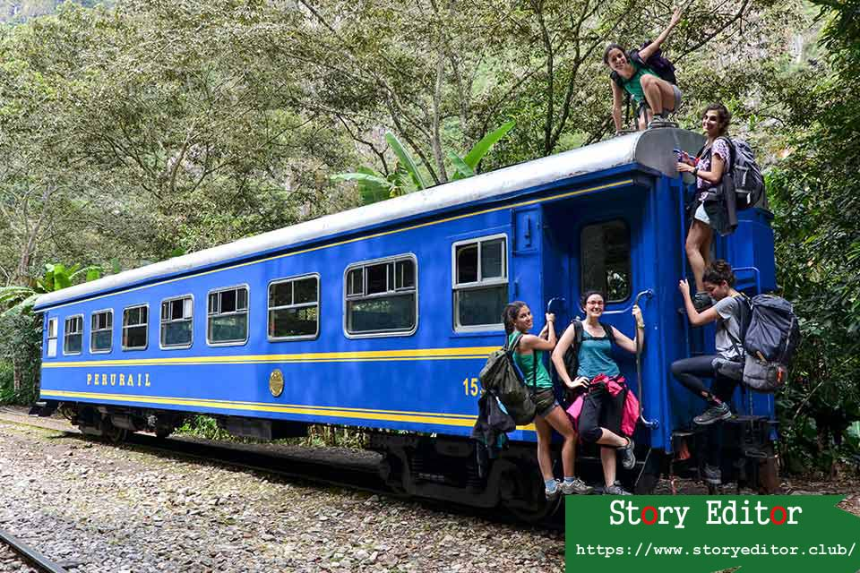 A group of tourists next to the train that connects the Hydroelectric Station with Aguas Calientes (Machu Picchu town)