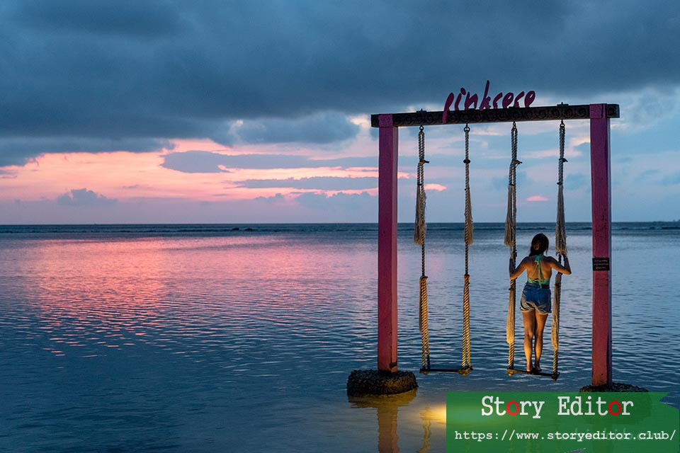 Tourist watching the sunset in Gili Islands (Indonesia)
