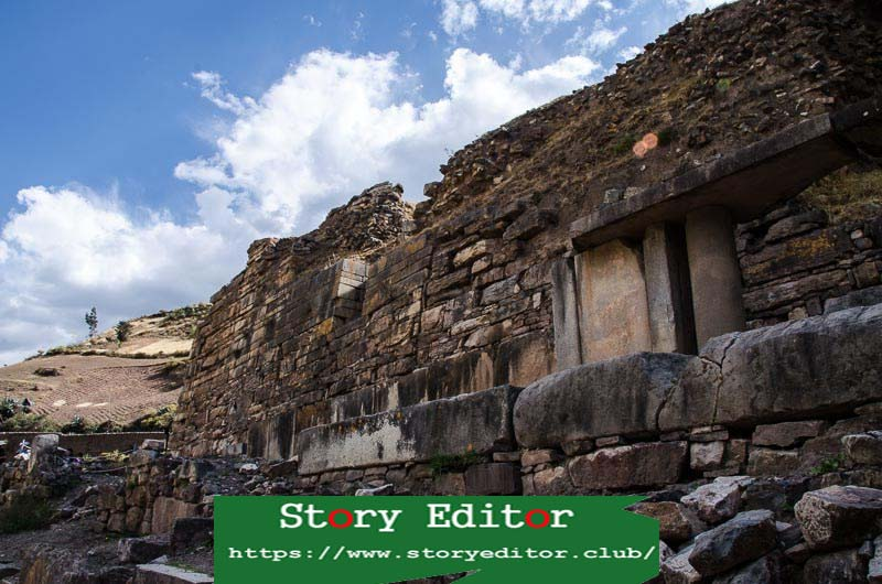 Chavin de Huantar stone wall with some columns in Peru