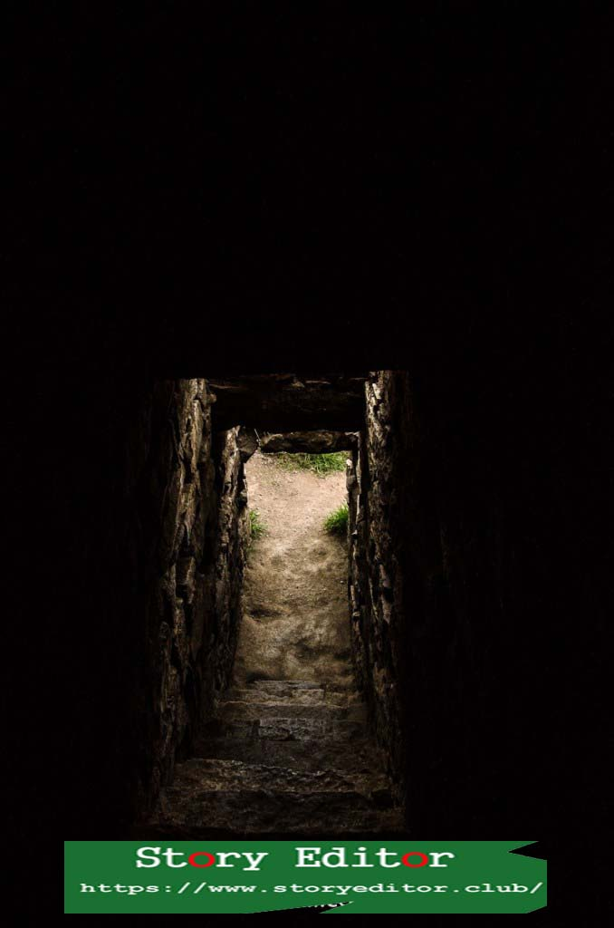 Dark corridor with stone stairs that go down to a rectangle of light from the outside in Chavín de Huántar one of the wonderful places of Peru